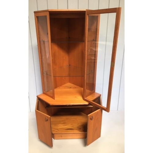 11 - A mid-century teak corner display cabinet by Turnidge of London. A glass doored, 2 shelved, display ...