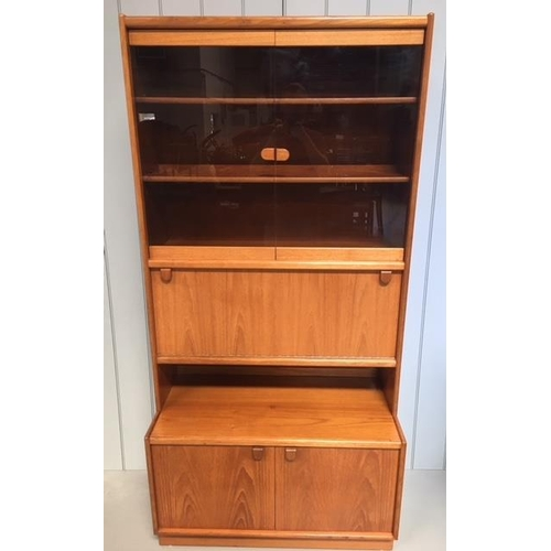 12 - A typical Remploy display cabinet. Glazed display area with 2 shelves, over a drop-down, mirror-back...