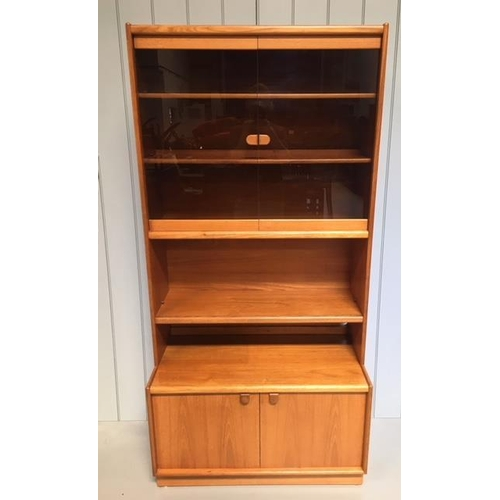 13 - A typical Remploy display cabinet. Glazed display area with 2 shelves, over a single teak shelf, ove...