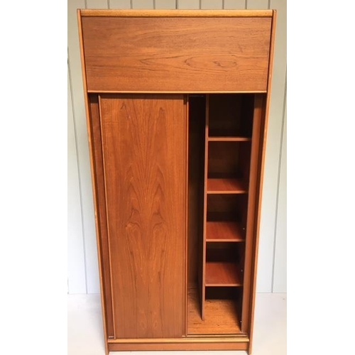 18 - A super mid-century Gents wardrobe by Austinsuite. Hinged top cupboard, over double sliding doors. I...