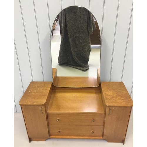 21 - A traditional single mirrored dressing table by Austinsuite. The large mirror sits over 2-drawers an...
