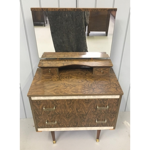 23 - A typical veneered retro dressing table. Large, full width mirror sits over 2 small drawers and in t...