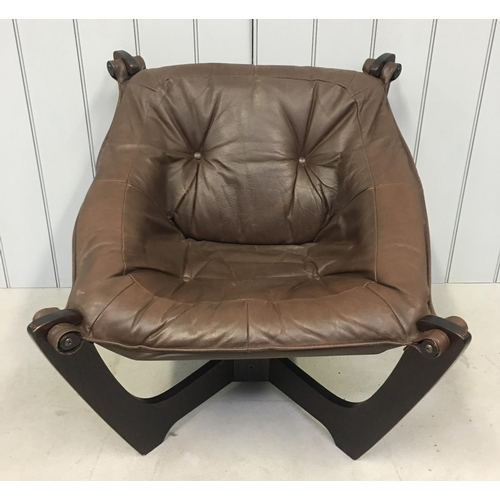 33 - A stunning retro leather lounge chair. Brown leather supported by Astro-style legs. Dimensions(cm) H...