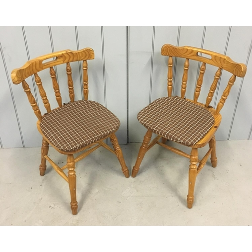 34 - A modern pair of pine, spindle-backed, kitchen chairs. Dimensions(cm) H79 W50 D40...