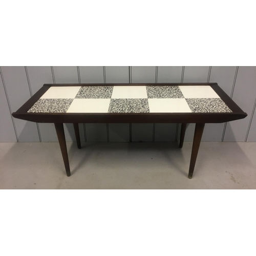 36 - A retro, tile effect coffee table by Remploy. Dates from 1965. Dimensions(cm) H41 W100 D40...