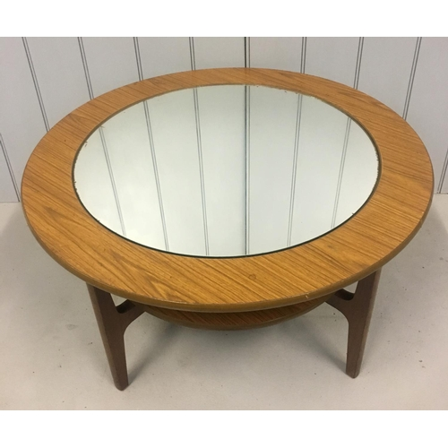 37 - A retro, circular coffee table. Centre table houses mirrored glass. Dimensions(cm) H46 W84 D84...