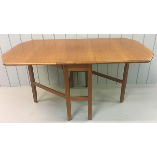 38 - A lovely mid-century gateleg extending teak table by