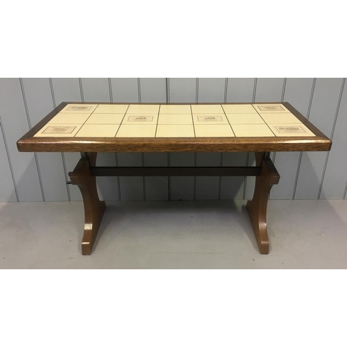 44 - An unusual vintage tiled coffee table, from the 1980's. The coffee table can be raised by 13cm to a ...
