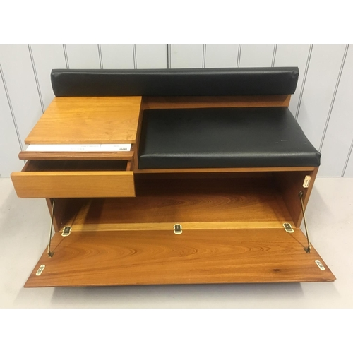 45 - A classic mid-century telephone seat by Chippy. The small table has an integrated drawer with origin...