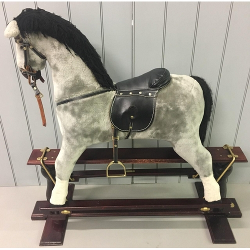 """A vintage cushioned rocking horse. """"Babylon"""" by Hannah'srockinghorse.co.uk. Grey with black mane & tail. Leather saddle. Missing one stirrup. Dimensions(cm) H112 (80 to seat) W121 D44"""