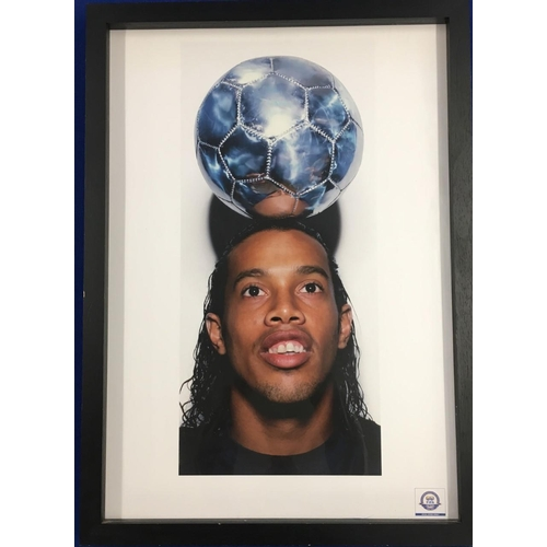 A rare print of Ronaldinho. Footballer Pele was asked to name his top 100 footballers for the FIFA centenary celebrations in 2004. Ronaldinho was one of the 100 and these rare prints were commissioned to celebrate. Height 90cm Width 65cm