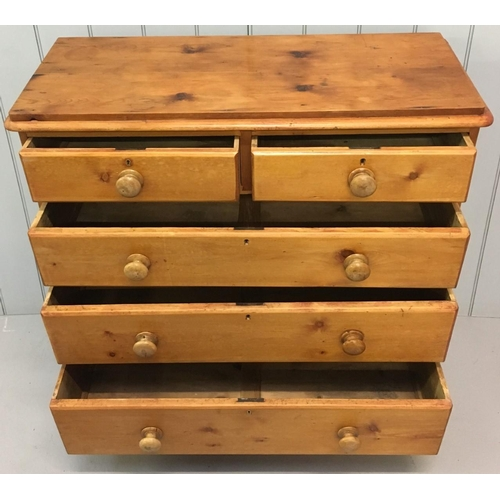 596 - A Victorian solid pine chest of drawers. 2 over 3 drawers, bun feet and handmade dovetail joints. No...
