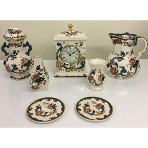 "Nine items of Mason's Ironstone ""Java"". 22ct gold gilded. Includes clock, bud vase, jug, su vase, su plates(x2) & a twin handled pot & lid (lid has some damage)."