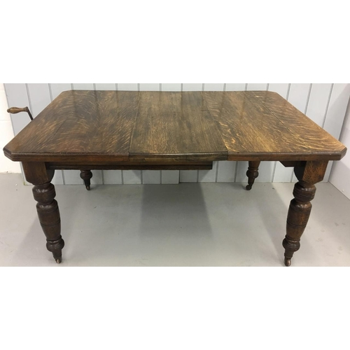 An extendable Edwardian dining table, with one extension leaf. Wind-out mechanism, with original handle present. Dimensions(cm) Open H75 W146 D100. Closed H75 W105 D100.