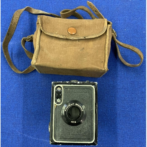 60 - A trio of vintage cameras including a Halina Super 8 Cine Camera, Ilford Sporti Camera and a Portrai...