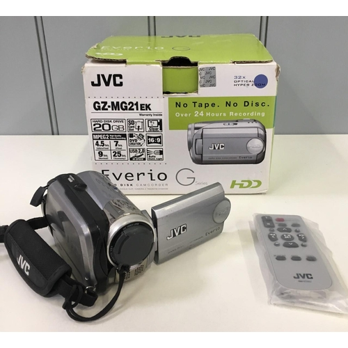 58 - A boxed JVC GZ-MG21EK HDD camcorder. Includes original leads, manual, battery, mains lead & SD card....