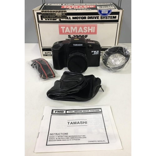 57 - A boxed, Tamashi S-1000X 35mm Camera. Appears complete.