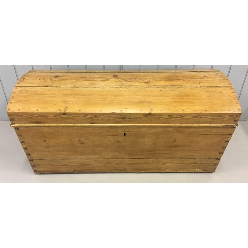 118 - A large, antique, solid Pine Trunk. Dovetailed joints, dome-shaped hinge lid. Dimensions(cm) H70 W13...