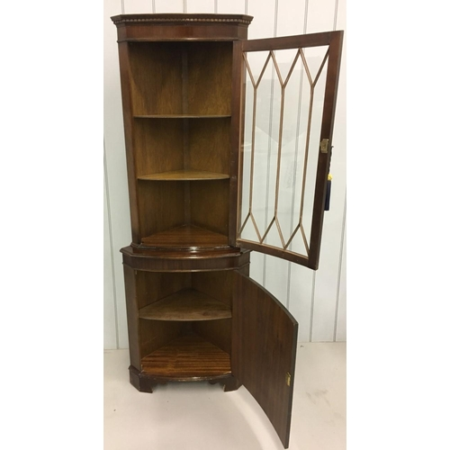 12 - A tall mahogany Corner Display Cabinet. Edwardian-style glass door above bow-fronted cupboard. Key p...