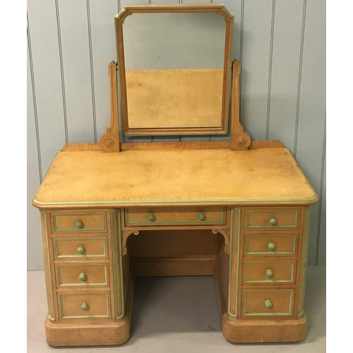 63 - A lovely dressing table by Lamb of Manchester. A swivel Mirror over a single central drawer, flanked...