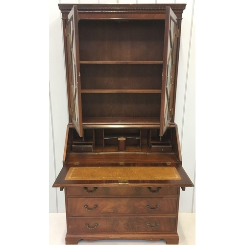 11 - A Mahogany, Edwardian Bureau Bookcase. Glazed bookcase with two internal shelves, over a 4-drawered ...