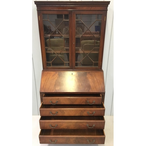 53 - A Mahogany, Edwardian Bureau Bookcase. Glazed bookcase with two internal shelves, over a 4-drawered ...