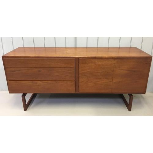 124 - A stunning 1960's Danish teak sideboard. Designed by Arne Hovmand Olsen for Mogens Kold. Three drawe...