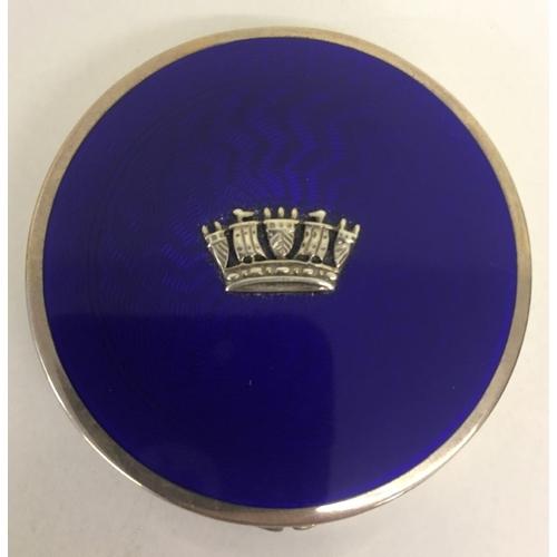 A beautiful Silver Pillbox, with blue Guilloche lid. Hallmarked. Birmingham 1931. Made by John William Barrett. Diameter 5cm.