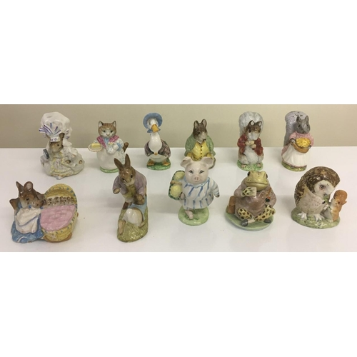 900 - A collection of eleven Beswick Beatrix Potter figures. Includes Benjamin Bunny & Peter Rabbit, Timmy...