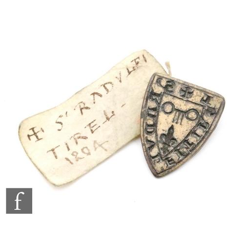 11 - A Medieval bronze heraldic seal for S' RADVLFI TIREL depicting a key of fleur de lys, loop to revers...