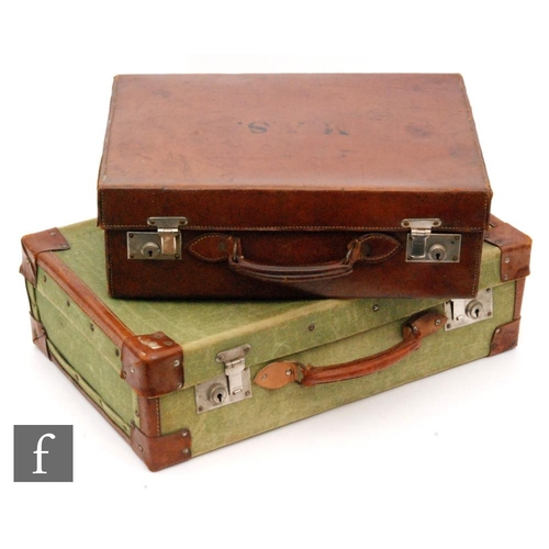 6 - A green canvas and leather mounted de-mob suitcase and a calf stitched leather suitcase, width 46cm....