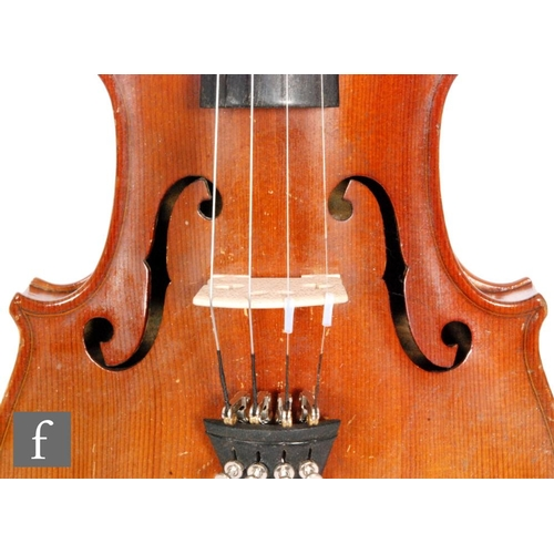 58 - A 1920 to 1930's violin, the reverse stamped Stainer, length of back 35.5cm and with a bow, cased....