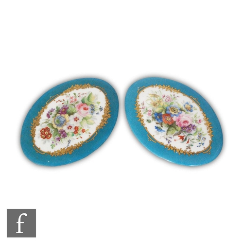31 - A pair of late 19th to early 20th Century oval plaques, each decorated with a hand painted spray of ...
