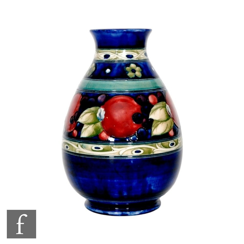 5 - A William Moorcroft Banded Pomegranate pattern vase of ovoid form with everted rim, decorated with a...