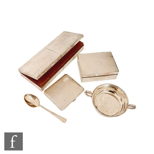 54 - Two hallmarked silver cigarette boxes, a silver cigarette case, a twin handled porringer and a silve...