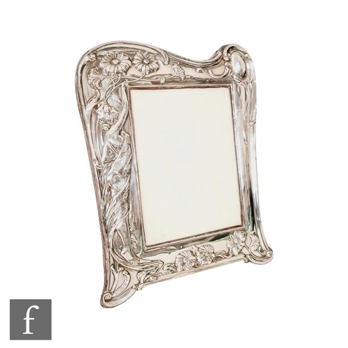 56 - An Art Nouveau hallmarked silver rectangular easel photograph frame with one side decorated with a s...