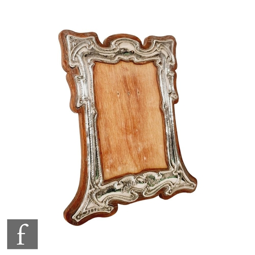 57 - An early 20th Century hallmarked silver rectangular easel photograph frame embossed with Dinna Forge...