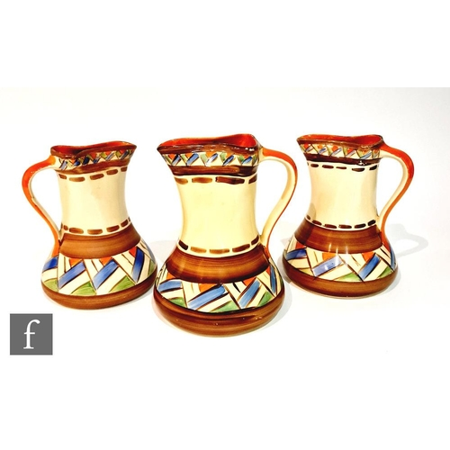 10 - A pair of 1930s Myott Art Deco pinch jugs decorated in pattern H8301 with hand painted brown banding...