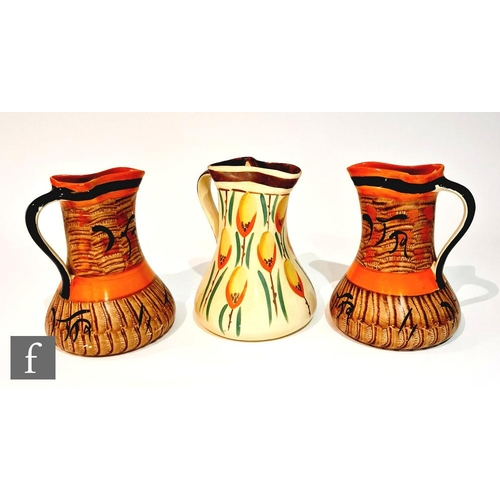 11 - A pair of 1930s Art Deco Myott pinch jugs decorated in pattern 8387, the whole with brown painted st...
