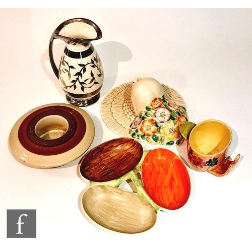 23 - Five pieces of assorted 1930s Art Deco pottery comprising a Solian Ware wall pocket, a Myott nut dis...