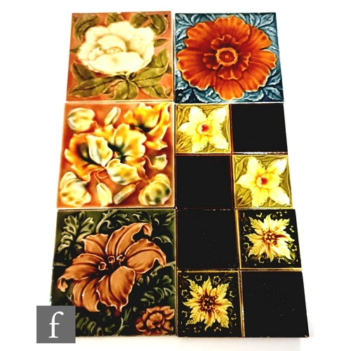 50 - Six assorted early 20th Century Art Nouveau 6in dust pressed tiles with raised floral decorationm to...