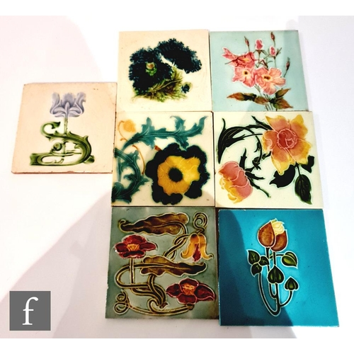 55 - Seven assorted early 20th Century 6in Art Nouveau dust pressed tiles each with a floral design to in...