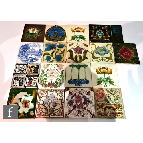 57 - Twelve assorted early 20th Century 6in Art Nouveau dust pressed tiles each with a floral design, to ...