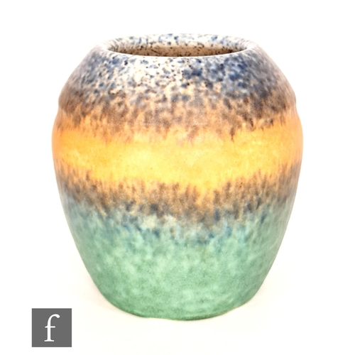 42 - Ruskin Pottery - A vase of swollen ovoid form with a slight banding to the shoulder decorated with a...
