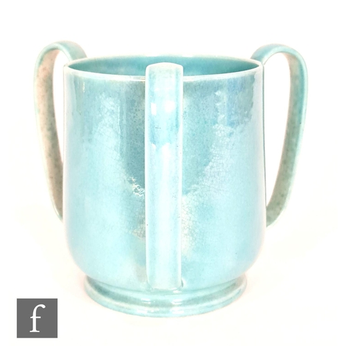 47 - Ruskin Pottery - A lustre glazed tyg vase decorated in an all over blue glaze, impressed mark and da...