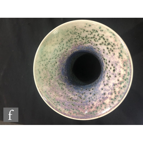 46 - Ruskin Pottery - A high fired vase of globe and flared shaft form decorated in a tonal lavender and ...