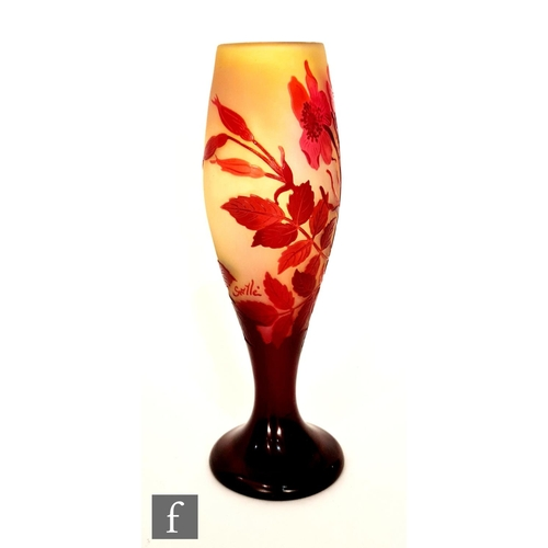 6 - Galle - An early 20th Century cameo glass vase of footed swollen form, cased in ruby over a graduate...