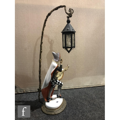 26 - K. Himmelstoss - Rosenthal - An early 20th Century table lamp modelled as Bajazzo, a harlequin stood...