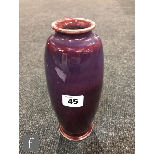 45 - Ruskin Pottery - A high fired vase of swollen form with a roll rim and slight flared foot decorated ...