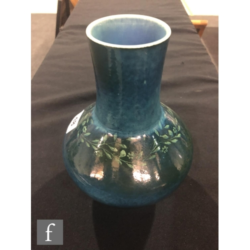 48 - Ruskin Pottery - A souffle glazed vase of angular form with a cylinder neck decorated in a mottled g...